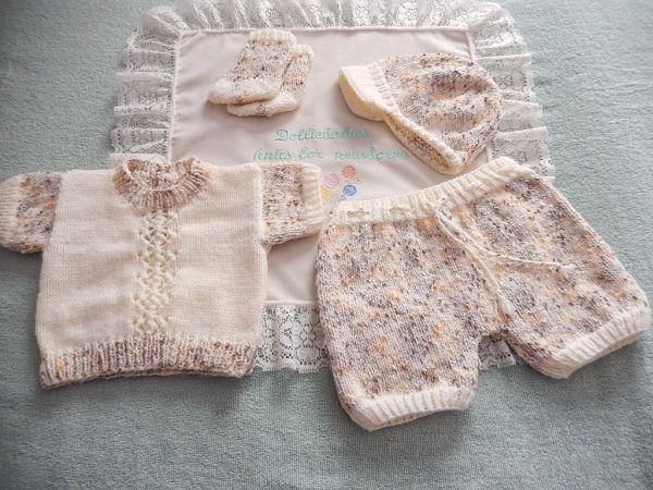 Baby Boy's Sweater, Shorts, Peaked Cap and Socks Knitting Pattern