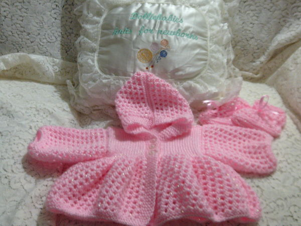 Free Baby or Reborn Doll Knitting Pattern For A Lacy Hooded Matinee Jacket With Matching Bootees